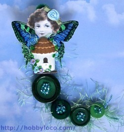 Mixed media button fairy art doll.