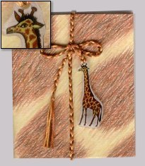 Photo showing handmade deco with giraffe Shrinky Dink adornment.