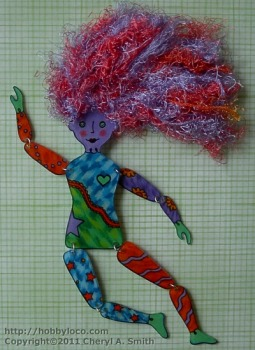 Photo showing shrinky dink art doll.